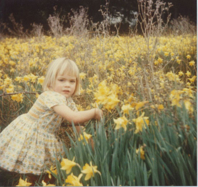 Young Beatrice picking daffodils in 1976
